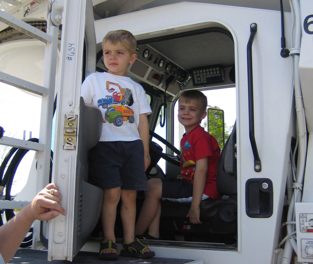 Photo of two boys sitting in one of our delivery trucks.