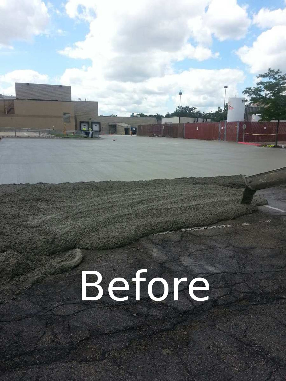 Cracked parking lot being filled with concrete
