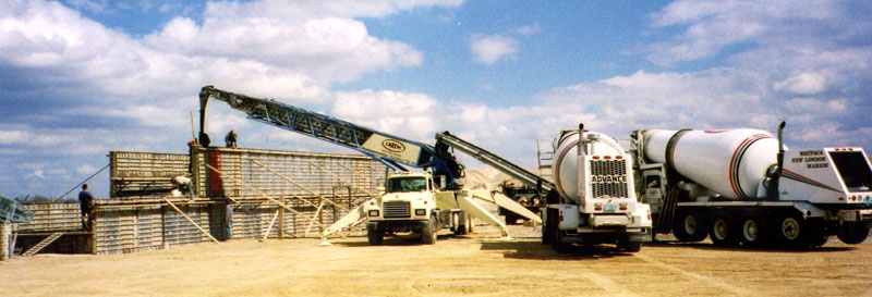 Picture of our cement mixers and placement conveyor at the job site